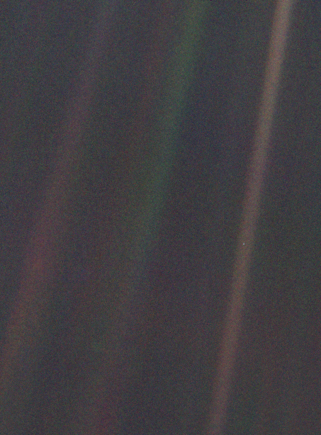 The 'Pale Blue Dot' image taken by Voyager 1 on February 14, 1990. The Earth is at middle right.